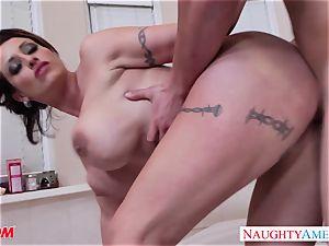 Eva wanks a dick with her titties
