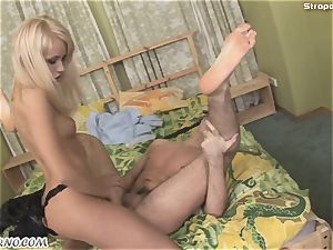 evil platinum-blonde in a leather suit punishes her bang-out marionette
