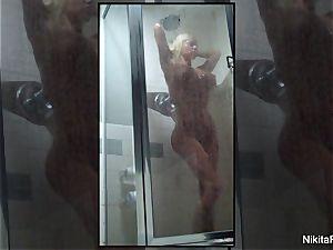 Home video of Nikita Von James taking a bathroom
