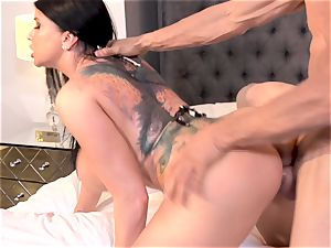 Axel Brauns tatted with honey Romi Rain