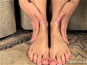 cool Capri Cavanni plays with her cute soles
