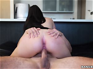 dark-haired vibing her clittie while getting pounded